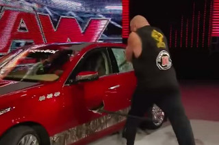 WWEs Brock Lesnar Demolishes a Cadillac CTS With an Axe