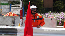 Marshal with a red flag
