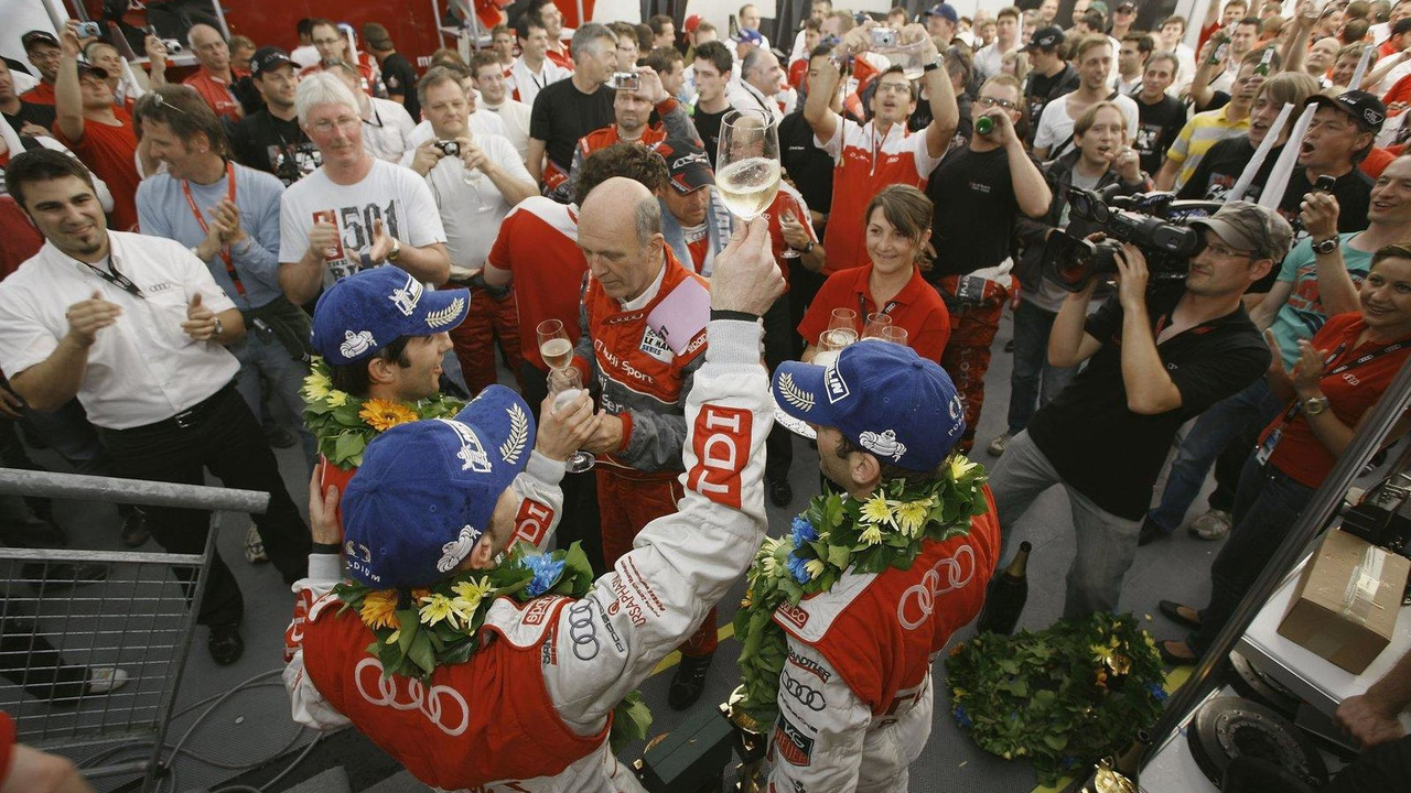 LMP1 podium: class and overall winners Mike Rockenfeller, Romain Dumas and Timo Bernhard celebrate with Dr. Wolfgang Ullrich, 24 Hour of Le Mans 2010, 04-11.06.2010 Le Mans, France