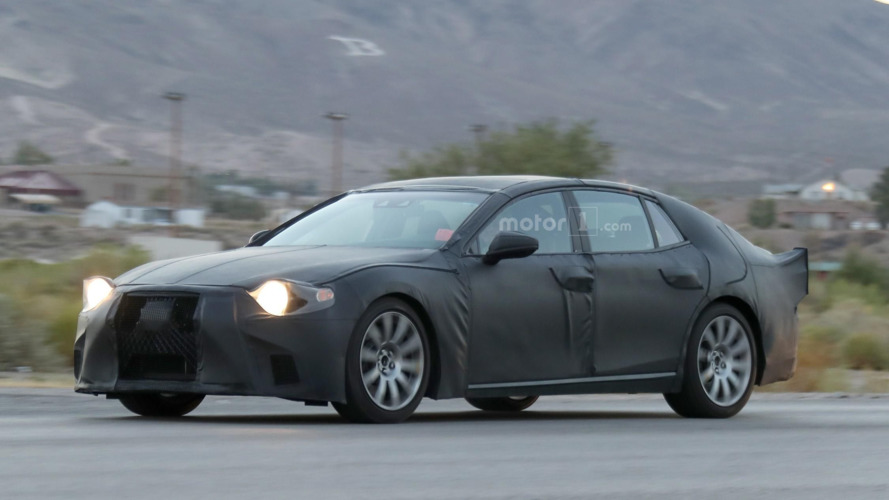 All-new Lexus LS puts on black dress to hide sleek body