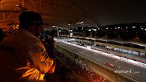 A fan watches Kimi Raikkonen, Ferrari SF70H, from the grandstand