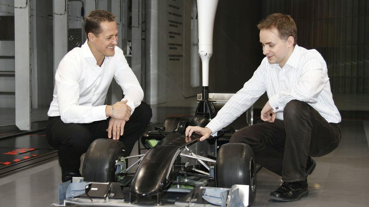 Michael Schumacher and John Owen in Wind Tunnel, Mercedes GP, Brackley, 23.12.2009