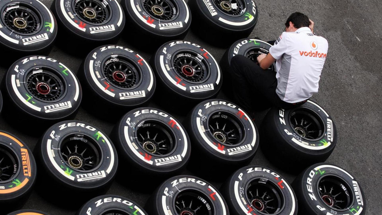 McLaren mechanic with Pirelli tyres 22.08.2013 Belgian Grand Prix