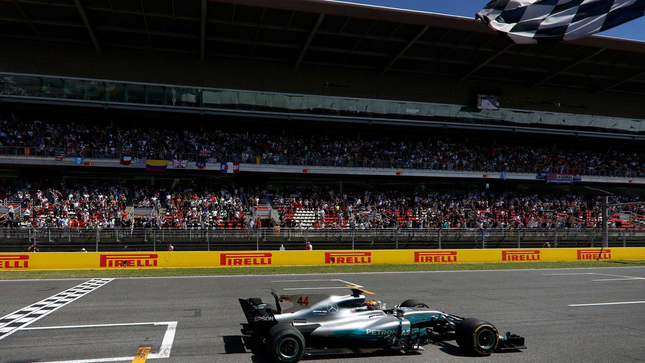 Lewis Hamilton, Mercedes AMG F1 W08, crosses the line and takes the chequered flag to win the race