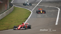 Kimi Raikkonen, Ferrari SF70H, leads Max Verstappen, Red Bull Racing RB13 and Valtteri Bottas, Mercedes AMG F1 W08