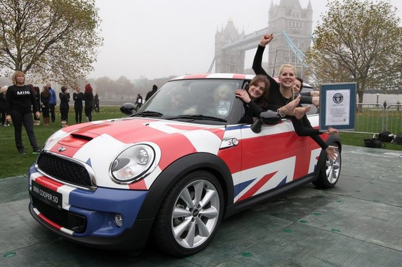 28 Flexible Females Squeeze into a MINI for a World Record
